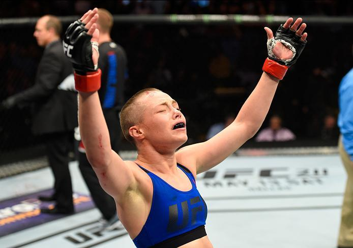 KANSAS CITY, MO - APRIL 15:  Rose Namajunas celebrates her submission victory over Michelle Waterson in their women's strawweight fight during the UFC Fight Night event at Sprint Center on April 15, 2017 in Kansas City, Missouri. (Photo by Josh Hedges/Zuf