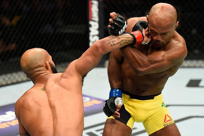 KANSAS CITY, MO - APRIL 15:  (L-R) Demetrious Johnson punches Wilson Reis of Brazil in their UFC flyweight fight during the UFC Fight Night event at Sprint Center on April 15, 2017 in Kansas City, Missouri. (Photo by Josh Hedges/Zuffa LLC/Zuffa LLC via Ge
