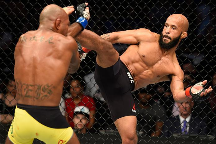 KANSAS CITY, MO - APRIL 15:  (R-L) Demetrious Johnson kicks Wilson Reis of Brazil in their UFC flyweight fight during the UFC Fight Night event at Sprint Center on April 15, 2017 in Kansas City, Missouri. (Photo by Josh Hedges/Zuffa LLC/Zuffa LLC via Gett