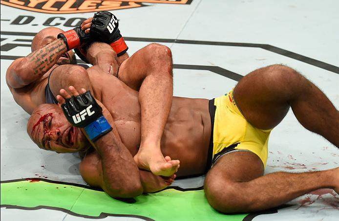KANSAS CITY, MO - APRIL 15:  (L-R) Demetrious Johnson submits Wilson Reis of Brazil in their UFC flyweight fight during the UFC Fight Night event at Sprint Center on April 15, 2017 in Kansas City, Missouri. (Photo by Josh Hedges/Zuffa LLC/Zuffa LLC via Ge