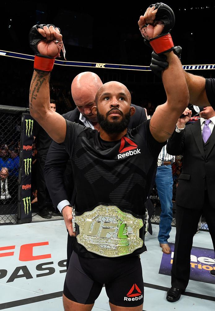 KANSAS CITY, MO - APRIL 15:  Demetrious Johnson celebrates his submission victory over Wilson Reis of Brazil in their UFC flyweight fight during the UFC Fight Night event at Sprint Center on April 15, 2017 in Kansas City, Missouri. (Photo by Josh Hedges/Z