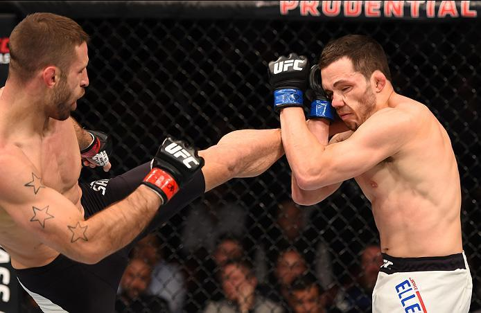 NEWARK, NJ - JANUARY 30:  (L-R) Tarec Saffiedine kicks Jake Ellenberger in their welterweight bout during the UFC Fight Night event at the Prudential Center on January 30, 2016 in Newark, New Jersey. (Photo by Josh Hedges/Zuffa LLC/Zuffa LLC via Getty Ima