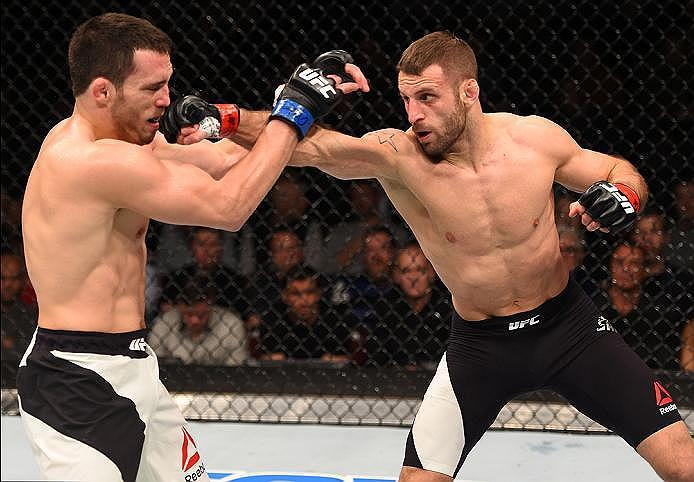 NEWARK, NJ - JANUARY 30:  (R-L) Tarec Saffiedine punches Jake Ellenberger in their welterweight bout during the UFC Fight Night event at the Prudential Center on January 30, 2016 in Newark, New Jersey. (Photo by Josh Hedges/Zuffa LLC/Zuffa LLC via Getty I