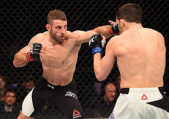 NEWARK, NJ - JANUARY 30:  (L-R) Tarec Saffiedine punches Jake Ellenberger in their welterweight bout during the UFC Fight Night event at the Prudential Center on January 30, 2016 in Newark, New Jersey. (Photo by Josh Hedges/Zuffa LLC/Zuffa LLC via Getty I
