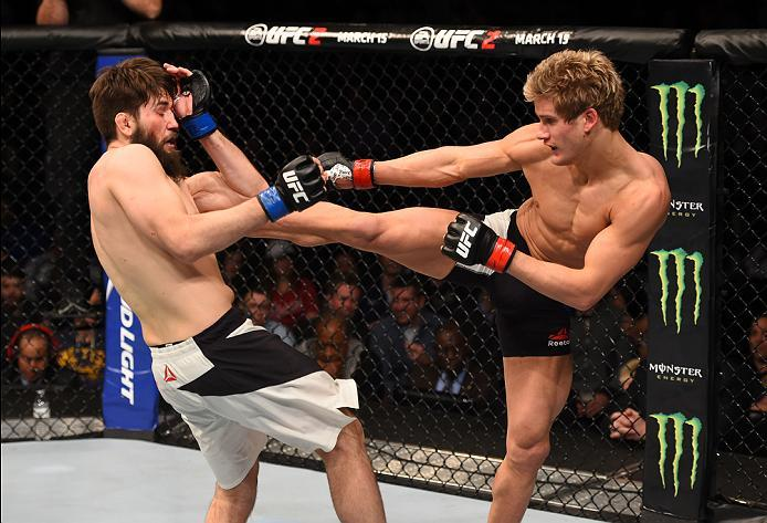 NEWARK, NJ - JANUARY 30:  (R-L) Sage Northcutt kicks Bryan Barberena in their welterweight bout during the UFC Fight Night event at the Prudential Center on January 30, 2016 in Newark, New Jersey. (Photo by Josh Hedges/Zuffa LLC/Zuffa LLC via Getty Images