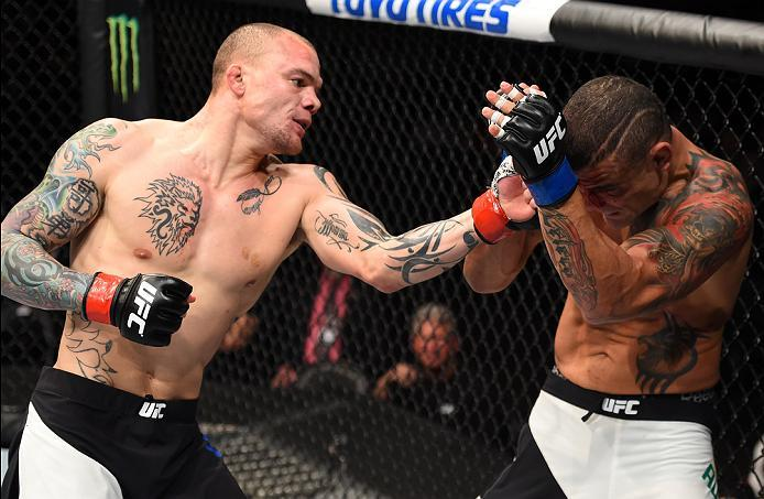PITTSBURGH, PA - FEBRUARY 21:  (L-R) Anthony Smith punches Leonardo Augusto Leleco in their middleweight bout during the UFC Fight Night event at Consol Energy Center on February 21, 2016 in Pittsburgh, Pennsylvania. (Photo by Jeff Bottari/Zuffa LLC/Zuffa