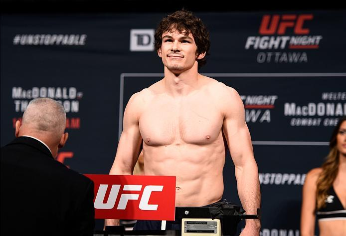 OTTAWA, ON - JUNE 17:  Olivier Aubin-Mercier of Canada steps on the scale during the UFC Fight Night Weigh-in inside the Arena at TD Place on June 17, 2016 in Ottawa, Ontario, Canada. (Photo by Jeff Bottari/Zuffa LLC/Zuffa LLC via Getty Images)