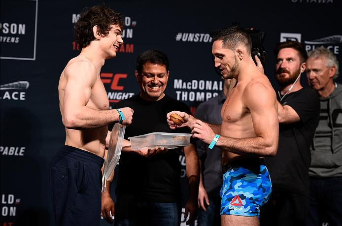 OTTAWA, ON - JUNE 17:  (L-R) Opponents Olivier Aubin-Mercier of Canada gives Thibault Gouti of France a muffin during the UFC Fight Night Weigh-in inside the Arena at TD Place on June 17, 2016 in Ottawa, Ontario, Canada. (Photo by Jeff Bottari/Zuffa LLC/Z