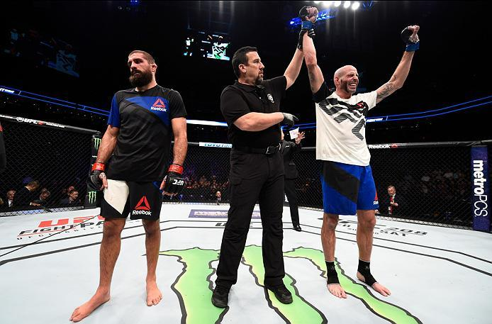 PHOENIX, AZ - JANUARY 15:  (R-L) Ben Saunders celebrates his victory over Court McGee in their welterweight bout during the UFC Fight Night event inside Talking Stick Resort Arena on January 15, 2017 in Phoenix, Arizona. (Photo by Jeff Bottari/Zuffa LLC/Z