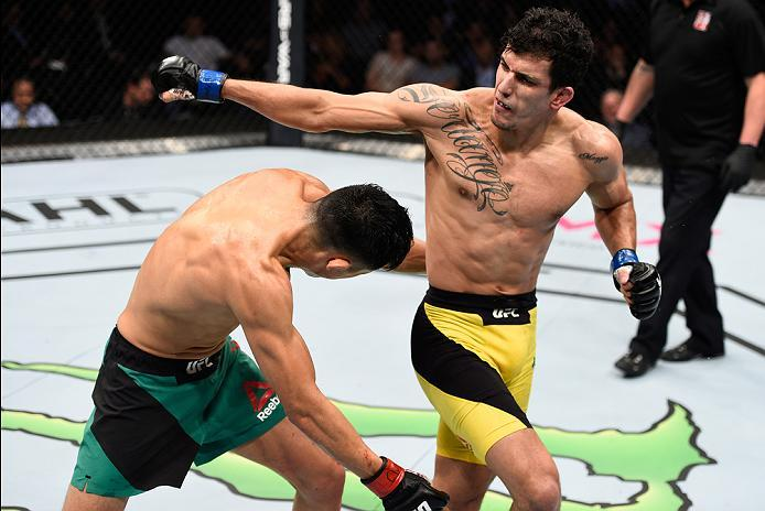MEXICO CITY, MEXICO - NOVEMBER 05:  (R-L) Felipe Arantes of Brazil throws a spinning back fist at Erik Perez of Mexico in their bantamweight bout during the UFC Fight Night event at Arena Ciudad de Mexico on November 5, 2016 in Mexico City, Mexico. (Photo