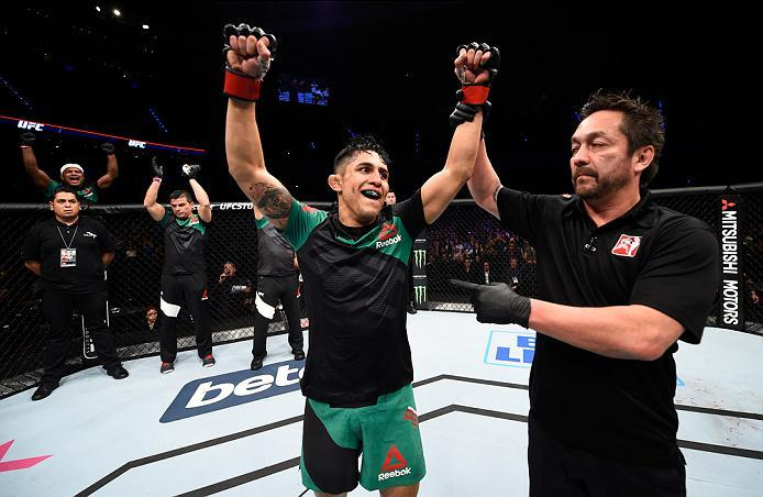 MEXICO CITY, MEXICO - NOVEMBER 05:  Erik Perez of Mexico celebrates his victory over Felipe Arantes of Brazil in their bantamweight bout during the UFC Fight Night event at Arena Ciudad de Mexico on November 5, 2016 in Mexico City, Mexico. (Photo by Jeff