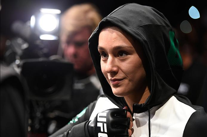MEXICO CITY, MEXICO - NOVEMBER 05:  Alexa Grasso of Mexico prepares to enter the Octagon before facing Heather Jo Clark of the United States in their women's strawweight bout during the UFC Fight Night event at Arena Ciudad de Mexico on November 5, 2016 i