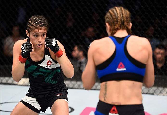 MEXICO CITY, MEXICO - NOVEMBER 05:  (L-R) Alexa Grasso of Mexico circles Heather Jo Clark of the United States in their women's strawweight bout during the UFC Fight Night event at Arena Ciudad de Mexico on November 5, 2016 in Mexico City, Mexico. (Photo