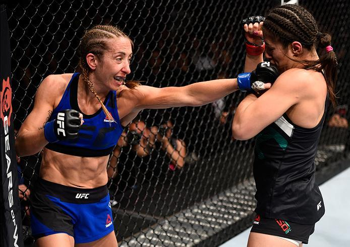 MEXICO CITY, MEXICO - NOVEMBER 05:  (L-R) Heather Jo Clark of the United States punches Alexa Grasso of Mexico in their women's strawweight bout during the UFC Fight Night event at Arena Ciudad de Mexico on November 5, 2016 in Mexico City, Mexico. (Photo
