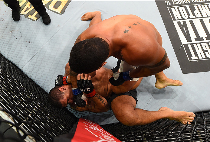 RIO DE JANEIRO, BRAZIL - AUGUST 01:  Soa Palelei of Australia (top) punches Antonio 'Bigfoot' Silva of Brazil in their heavyweight bout during the UFC 190 event inside HSBC Arena on August 1, 2015 in Rio de Janeiro, Brazil.  (Photo by Josh Hedges/Zuffa LL
