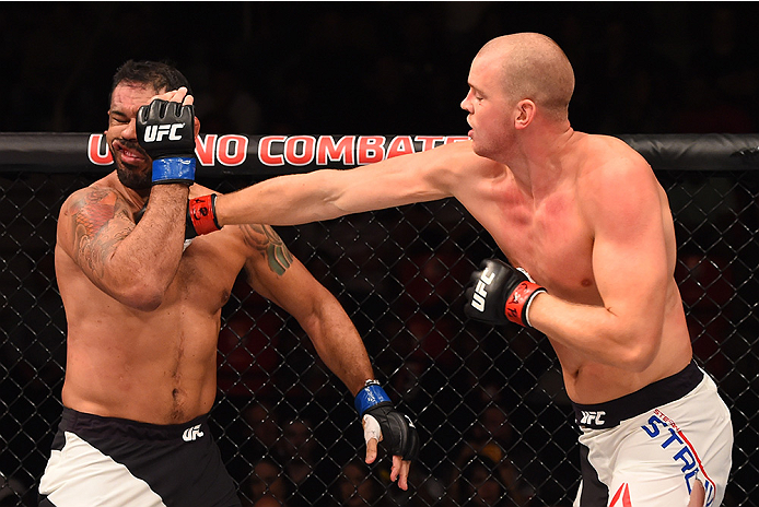 RIO DE JANEIRO, BRAZIL - AUGUST 01:  (R-L) Stefan Struve of the Netherlands punches Rodrigo 'Minotauro' Nogueira of Brazil  in their heavyweight bout during the UFC 190 event inside HSBC Arena on August 1, 2015 in Rio de Janeiro, Brazil.  (Photo by Josh H