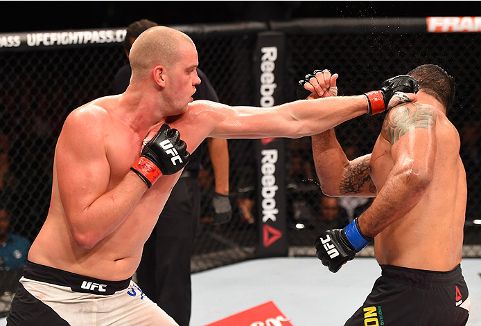 RIO DE JANEIRO, BRAZIL - AUGUST 01:  (L-R) Stefan Struve of the Netherlands punches Rodrigo 'Minotauro' Nogueira of Brazil  in their heavyweight bout during the UFC 190 event inside HSBC Arena on August 1, 2015 in Rio de Janeiro, Brazil.  (Photo by Josh H