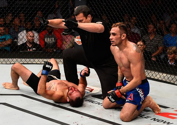 SIOUX FALLS, SD - JULY 13:   (R-L) Tony Ferguson celebrates his submission victory over Lando Vannat in their lightweight bout during the UFC Fight Night event on July 13, 2016 at Denny Sanford Premier Center in Sioux Falls, South Dakota. (Photo by Jeff B