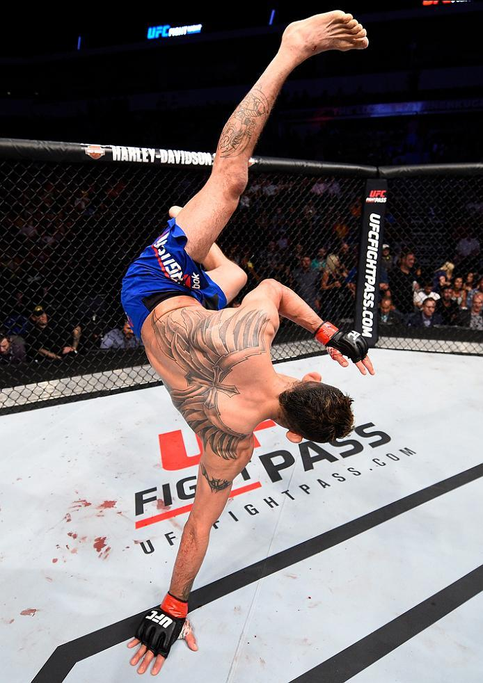 SIOUX FALLS, SD - JULY 13:   Tony Ferguson celebrates his submission victory over Lando Vannat in their lightweight bout during the UFC Fight Night event on July 13, 2016 at Denny Sanford Premier Center in Sioux Falls, South Dakota. (Photo by Jeff Bottari