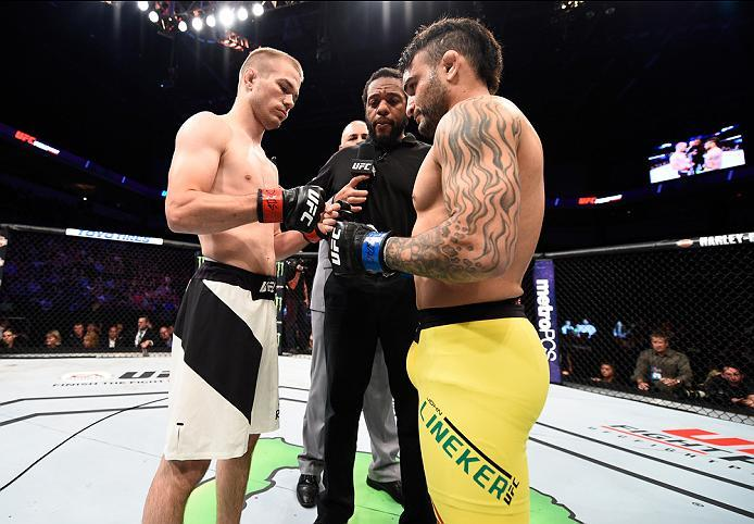 SIOUX FALLS, SD - JULY 13:   (R-L) John Lineker and Michael McDonald touch gloves in their bantamweight bout during the UFC Fight Night event on July 13, 2016 at Denny Sanford Premier Center in Sioux Falls, South Dakota. (Photo by Jeff Bottari/Zuffa LLC/Z