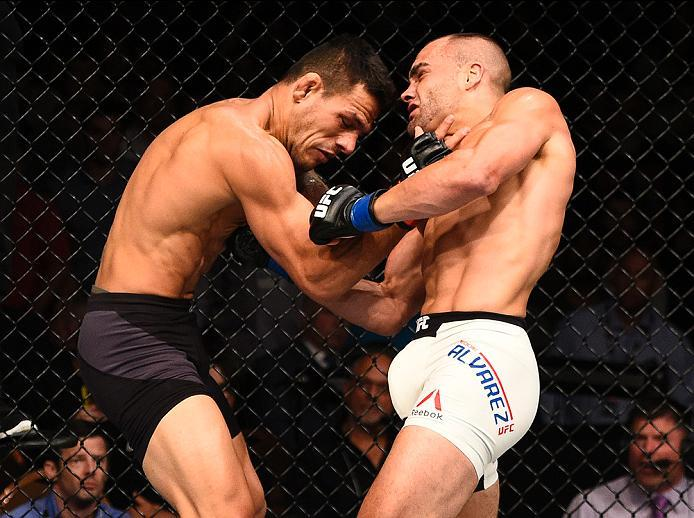 LAS VEGAS, NV - JULY 07:   (R-L) Eddie Alvarez punches Rafael Dos Anjos of Brazil in their lightweight championship bout during the UFC Fight Night event inside the MGM Grand Garden Arena on July 7, 2016 in Las Vegas, Nevada. (Photo by Jeff Bottari/Zuffa