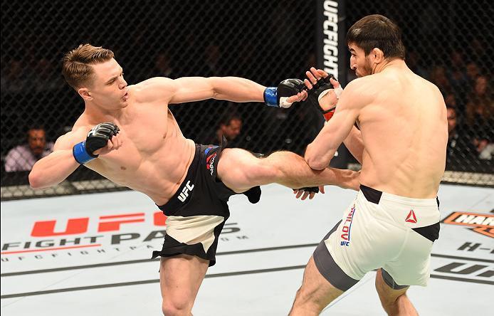 ROTTERDAM, NETHERLANDS - MAY 08:  (L-R) Chris Wade kicks Rustam Khabilov in their lightweight bout during the UFC Fight Night event at Ahoy Rotterdam on May 8, 2016 in Rotterdam, Netherlands. (Photo by Josh Hedges/Zuffa LLC/Zuffa LLC via Getty Images)