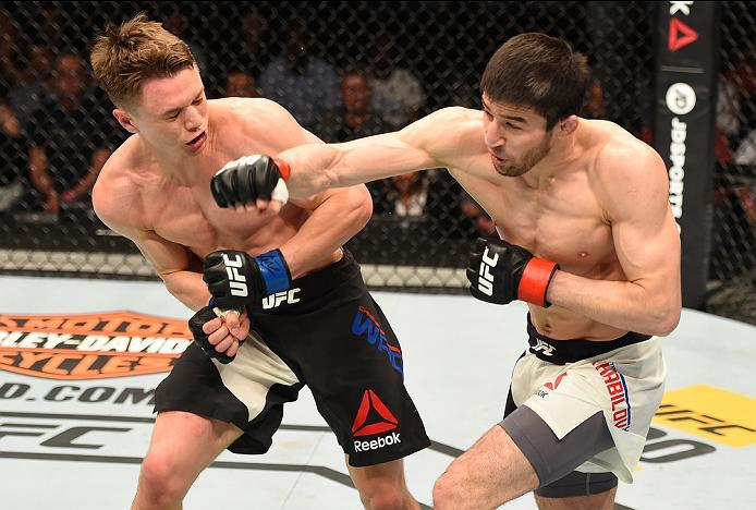 ROTTERDAM, NETHERLANDS - MAY 08:  (R-L) Rustam Khabilov punches Chris Wade in their lightweight bout during the UFC Fight Night event at Ahoy Rotterdam on May 8, 2016 in Rotterdam, Netherlands. (Photo by Josh Hedges/Zuffa LLC/Zuffa LLC via Getty Images)