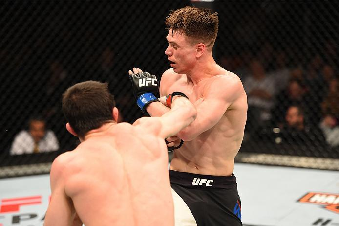 ROTTERDAM, NETHERLANDS - MAY 08:  (L-R) Rustam Khabilov punches Chris Wade in their lightweight bout during the UFC Fight Night event at Ahoy Rotterdam on May 8, 2016 in Rotterdam, Netherlands. (Photo by Josh Hedges/Zuffa LLC/Zuffa LLC via Getty Images)