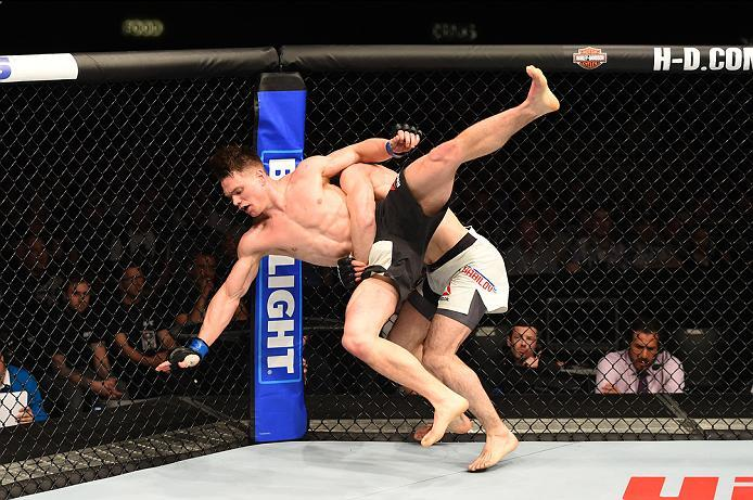 ROTTERDAM, NETHERLANDS - MAY 08:  (R-L) Rustam Khabilov takes down Chris Wade in their lightweight bout during the UFC Fight Night event at Ahoy Rotterdam on May 8, 2016 in Rotterdam, Netherlands. (Photo by Josh Hedges/Zuffa LLC/Zuffa LLC via Getty Images