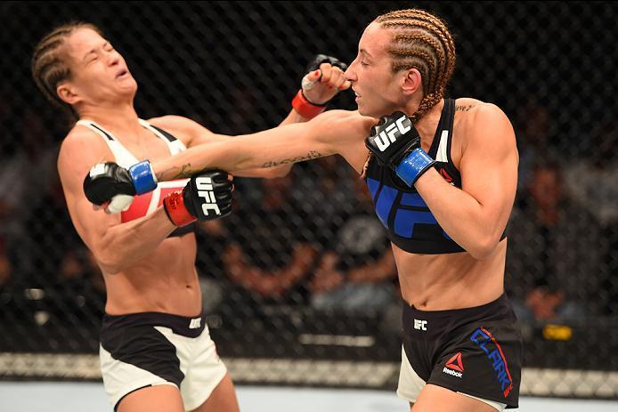 ROTTERDAM, NETHERLANDS - MAY 08:  (R-L) Heather Jo Clark punches Karolina Kowalkiewicz in their women's strawweight bout during the UFC Fight Night event at Ahoy Rotterdam on May 8, 2016 in Rotterdam, Netherlands. (Photo by Josh Hedges/Zuffa LLC/Zuffa LLC