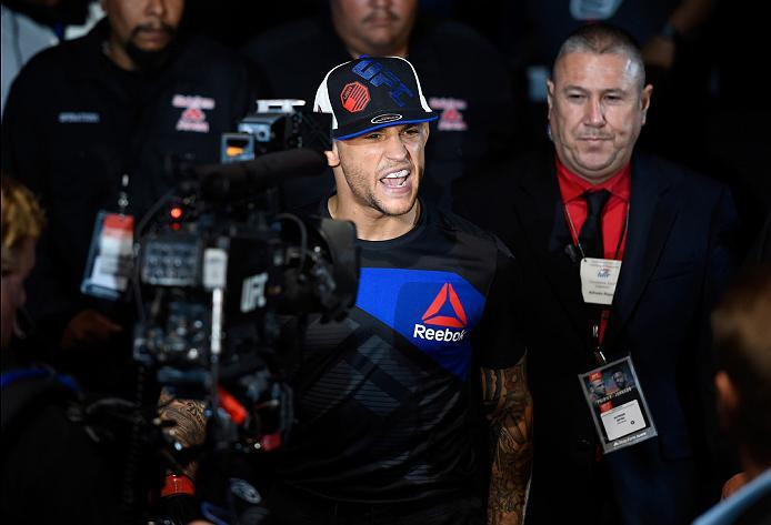 HIDALGO, TX - SEPTEMBER 17:   Dustin Poirier prepares to enter the Octagon before facing Michael Johnson in their lightweight bout during the UFC Fight Night event at State Farm Arena on September 17, 2016 in Hidalgo, Texas. (Photo by Josh Hedges/Zuffa LL