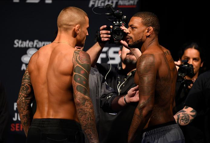 HIDALGO, TX - SEPTEMBER 16:  (L-R) Dustin Poirier of the United States and Michael Johnson of the United States face off during the UFC Fight Night weigh-in at the State Farm Arena on September 16, 2016 in Hidalgo, Texas. (Photo by Josh Hedges/Zuffa LLC/Z