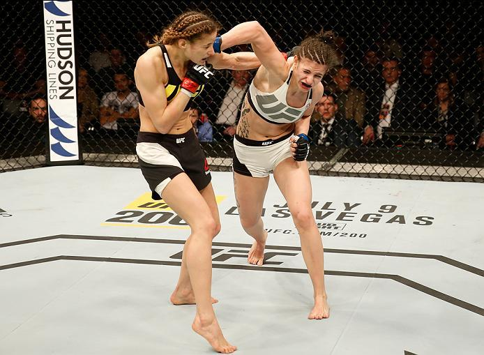 ZAGREB, CROATIA - APRIL 10:   (R-L) Cristina Stanciu punches Maryna Moroz in their strawweight bout during the UFC Fight Night event at the Arena Zagreb on April 10, 2016 in Zagreb, Croatia. (Photo by Srdjan Stevanovic/Zuffa LLC/Zuffa LLC via Getty Images