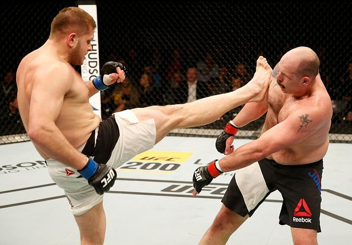 ZAGREB, CROATIA - APRIL 10:   (L-R) Marcin Tybura kicks Timothy Johnson in their heavyweight bout during the UFC Fight Night event at the Arena Zagreb on April 10, 2016 in Zagreb, Croatia. (Photo by Srdjan Stevanovic/Zuffa LLC/Zuffa LLC via Getty Images)