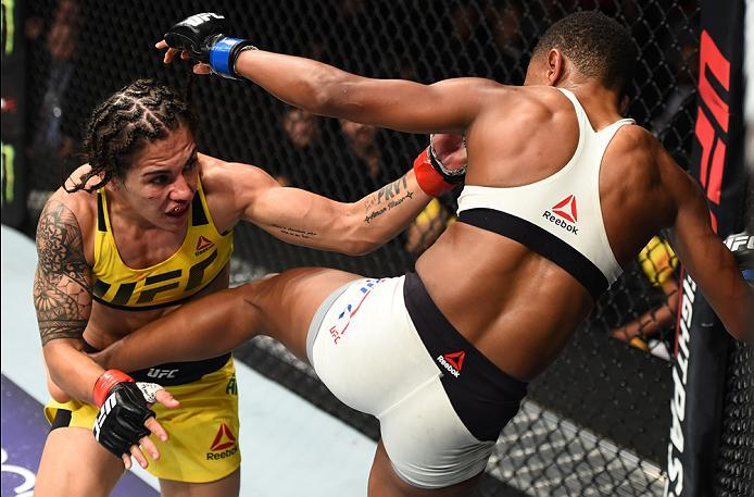 HOUSTON, TX - FEBRUARY 04:  (R-L) Angela Hill kicks Jessica Andrade of Brazil in their women's strawweight bout during the UFC Fight Night event at the Toyota Center on February 4, 2017 in Houston, Texas. (Photo by Jeff Bottari/Zuffa LLC/Zuffa LLC via Get
