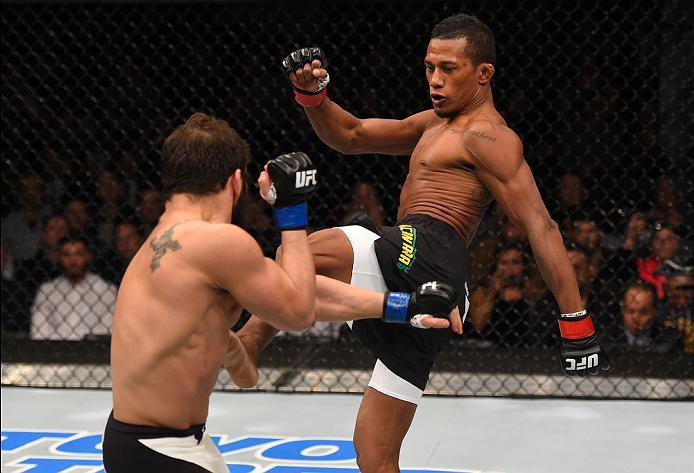 NEWARK, NJ - JANUARY 30:  (R-L) Iuri Alcantara kicks Jimmie Rivera in their bantamweight bout during the UFC Fight Night event at the Prudential Center on January 30, 2016 in Newark, New Jersey. (Photo by Josh Hedges/Zuffa LLC/Zuffa LLC via Getty Images)