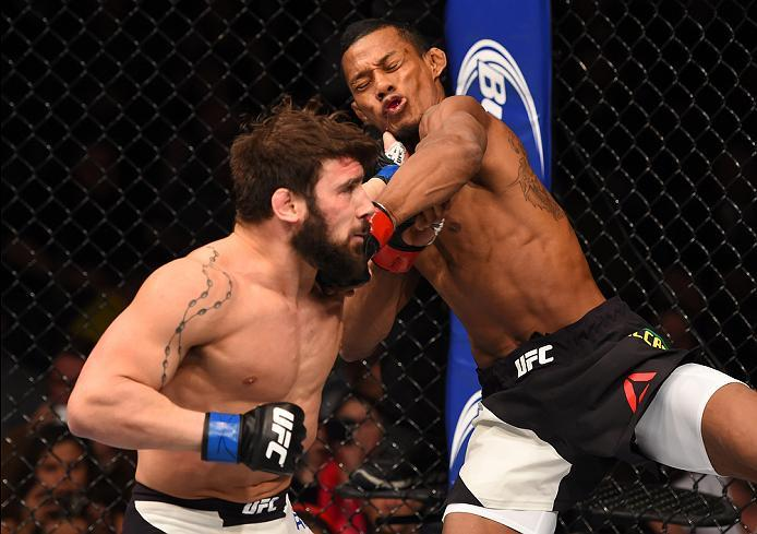 NEWARK, NJ - JANUARY 30:  (L-R) Jimmie Rivera punches Iuri Alcantara in their bantamweight bout during the UFC Fight Night event at the Prudential Center on January 30, 2016 in Newark, New Jersey. (Photo by Josh Hedges/Zuffa LLC/Zuffa LLC via Getty Images