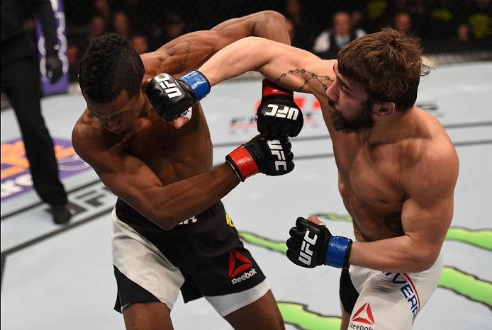 NEWARK, NJ - JANUARY 30:  (R-L) Jimmie Rivera punches Iuri Alcantara in their bantamweight bout during the UFC Fight Night event at the Prudential Center on January 30, 2016 in Newark, New Jersey. (Photo by Josh Hedges/Zuffa LLC/Zuffa LLC via Getty Images