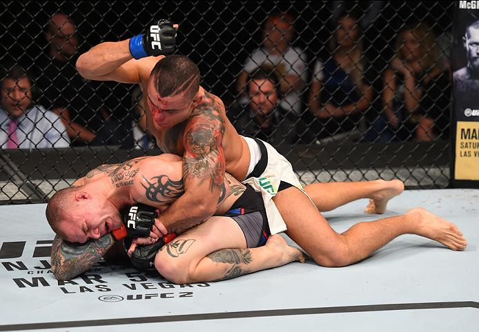 PITTSBURGH, PA - FEBRUARY 21:  Leonardo Augusto Leleco (top) punches Anthony Smith in their middleweight bout during the UFC Fight Night event at Consol Energy Center on February 21, 2016 in Pittsburgh, Pennsylvania. (Photo by Jeff Bottari/Zuffa LLC/Zuffa