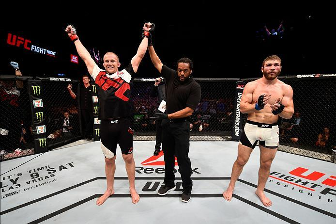 OTTAWA, ON - JUNE 18:   (L-R) Misha Cirkunov of Latvia celebrates his submission victory over Ion Cutelaba of the Republic of Moldova in their light heavyweight bout during the UFC Fight Night event inside the TD Place Arena on June 18, 2016 in Ottawa, On