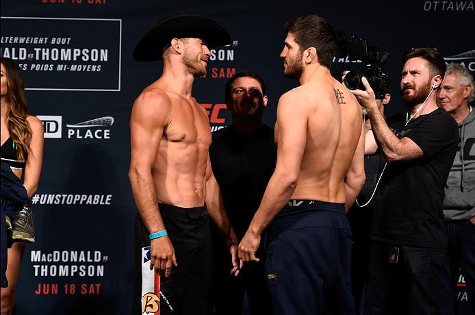 OTTAWA, ON - JUNE 17:  (L-R) Opponents Donald Cerrone of the United States and Patrick Cote of Canada face off during the UFC Fight Night Weigh-in inside the Arena at TD Place on June 17, 2016 in Ottawa, Ontario, Canada. (Photo by Jeff Bottari/Zuffa LLC/Z
