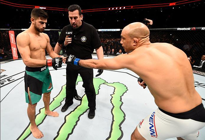 PHOENIX, AZ - JANUARY 15:  (R-L) BJ Penn touches gloves with Yair Rodriguez of Mexico in their featherweight bout during the UFC Fight Night event inside Talking Stick Resort Arena on January 15, 2017 in Phoenix, Arizona. (Photo by Jeff Bottari/Zuffa LLC/