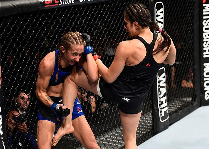 MEXICO CITY, MEXICO - NOVEMBER 05:  (R-L) Alexa Grasso of Mexico knees Heather Jo Clark of the United States in their women's strawweight bout during the UFC Fight Night event at Arena Ciudad de Mexico on November 5, 2016 in Mexico City, Mexico. (Photo by