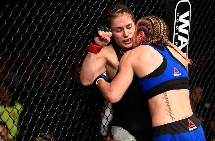 MEXICO CITY, MEXICO - NOVEMBER 05:  (R-L) Heather Jo Clark of the United States pushes Alexa Grasso of Mexico up against the cage in their women's strawweight bout during the UFC Fight Night event at Arena Ciudad de Mexico on November 5, 2016 in Mexico Ci
