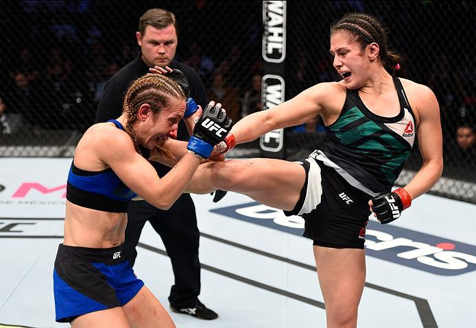 MEXICO CITY, MEXICO - NOVEMBER 05:  (R-L) Alexa Grasso of Mexico kicks Heather Jo Clark of the United States in their women's strawweight bout during the UFC Fight Night event at Arena Ciudad de Mexico on November 5, 2016 in Mexico City, Mexico. (Photo by