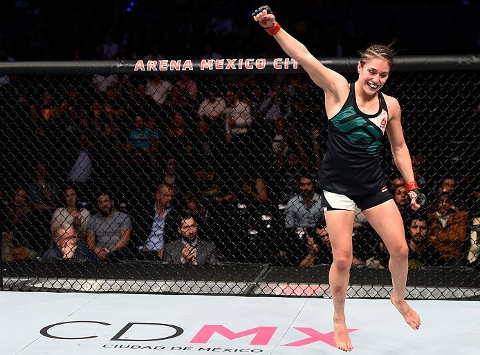 MEXICO CITY, MEXICO - NOVEMBER 05:  Alexa Grasso of Mexico raises her hands after facing Heather Jo Clark of the United States in their women's strawweight bout during the UFC Fight Night event at Arena Ciudad de Mexico on November 5, 2016 in Mexico City,