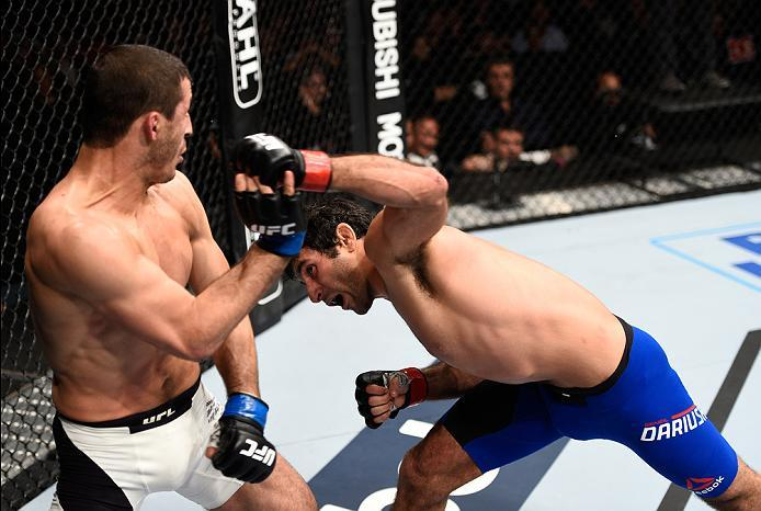 MEXICO CITY, MEXICO - NOVEMBER 05:  (R-L) Beneil Dariush of Iran punches Rashid Magomedov of Russia in their lightweight bout during the UFC Fight Night event at Arena Ciudad de Mexico on November 5, 2016 in Mexico City, Mexico. (Photo by Jeff Bottari/Zuf