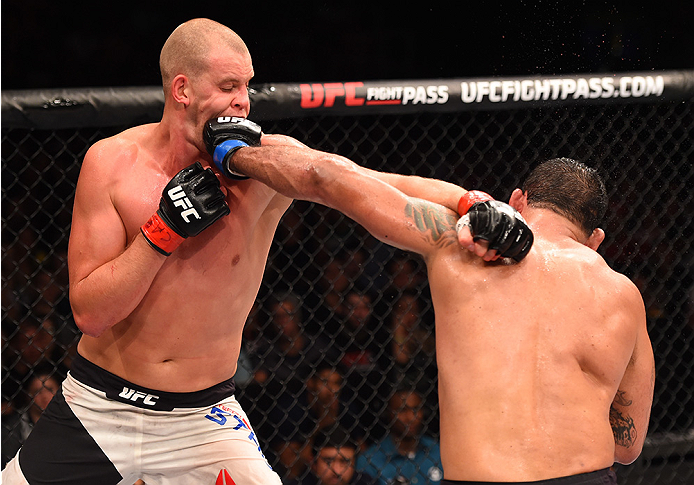 RIO DE JANEIRO, BRAZIL - AUGUST 01:  (R-L) Rodrigo 'Minotauro' Nogueira of Brazil punches Stefan Struve of the Netherlands in their heavyweight bout during the UFC 190 event inside HSBC Arena on August 1, 2015 in Rio de Janeiro, Brazil.  (Photo by Josh He