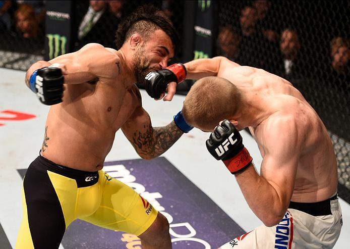 SIOUX FALLS, SD - JULY 13:   (R-L) Michael McDonald punches John Lineker in their bantamweight bout during the UFC Fight Night event on July 13, 2016 at Denny Sanford Premier Center in Sioux Falls, South Dakota. (Photo by Jeff Bottari/Zuffa LLC/Zuffa LLC