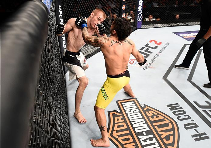 SIOUX FALLS, SD - JULY 13:   (R-L) John Lineker exchanges punches with Michael McDonald in their bantamweight bout during the UFC Fight Night event on July 13, 2016 at Denny Sanford Premier Center in Sioux Falls, South Dakota. (Photo by Jeff Bottari/Zuffa